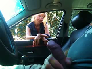 Busty Blonde MILF Gives A Blowjob To A Black Stud Outdoors